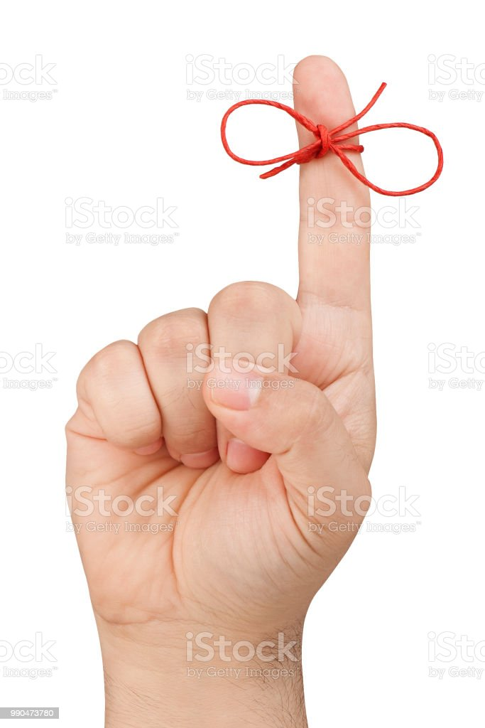 Red Bow on top of forefinger of front view male hand for reminding isolated stock photo
