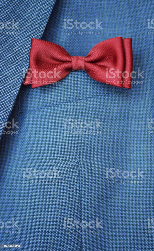 Red bow tie on blue suit jacket background. Happy Fathers day or...