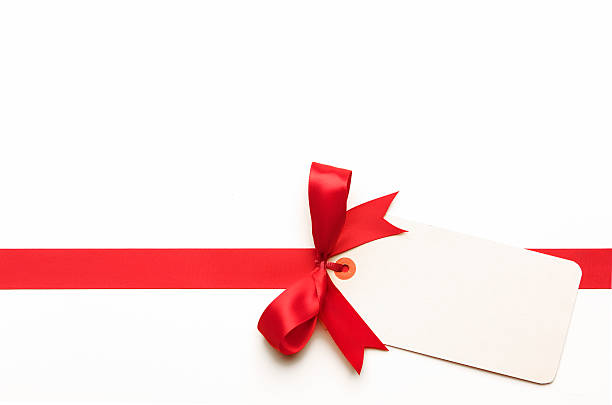 red bow with blank tag - label stock pictures, royalty-free photos & images
