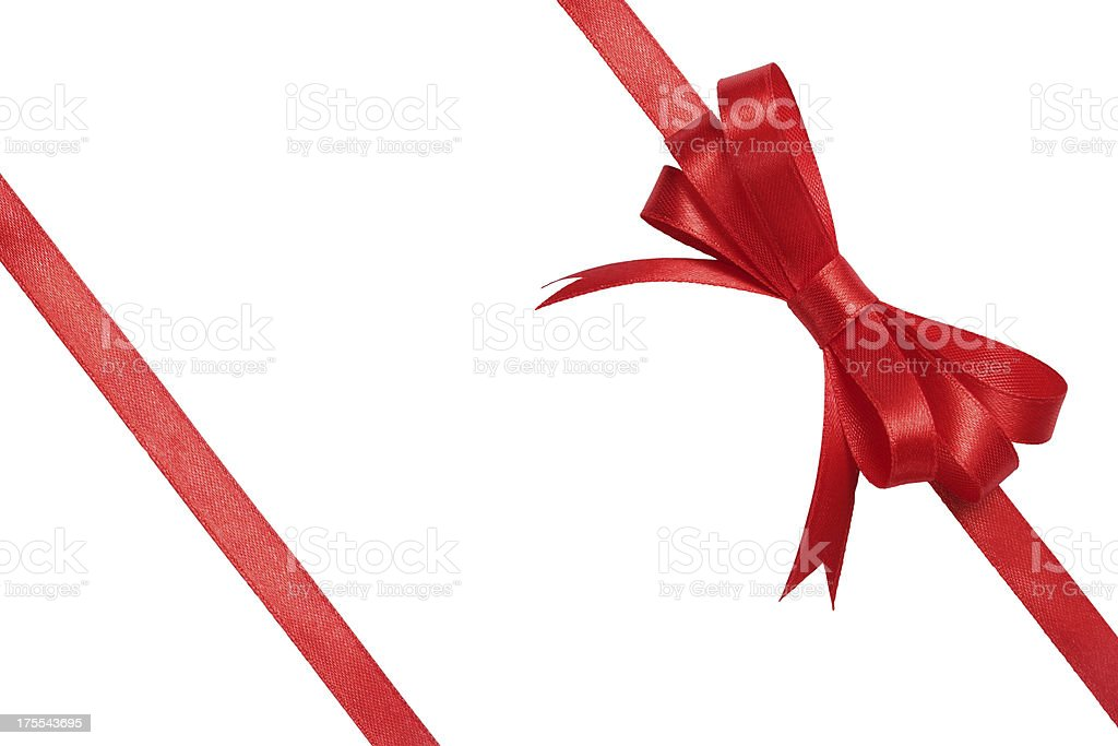 Red bow wrapped around white background stock photo