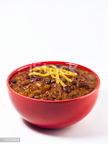 A hot generous helping of fresh homemade spicy chili with beans, hearty beef, sweet onion, and fresh tomato topped with shredded cheddar cheese.