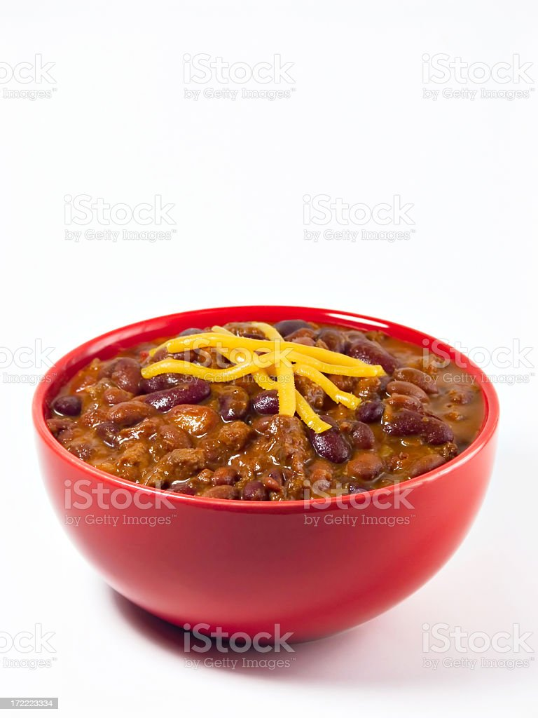 A red bowl full of chili on a white background stock photo