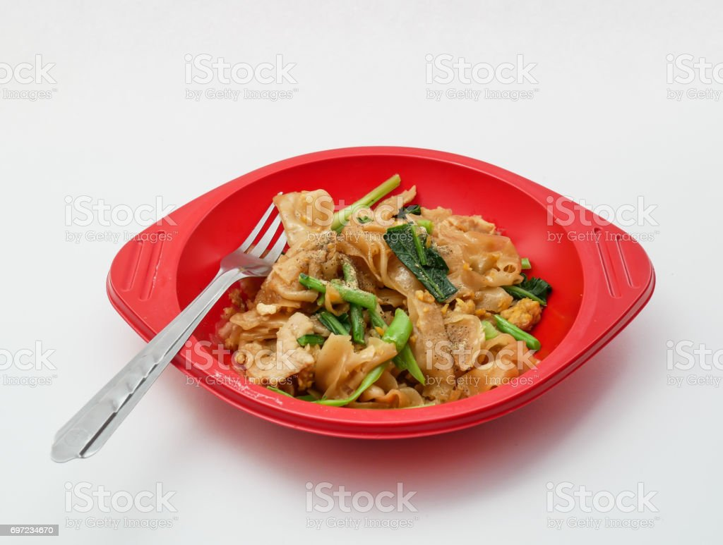 Red bowl of frozen food ready to eat on white stock photo
