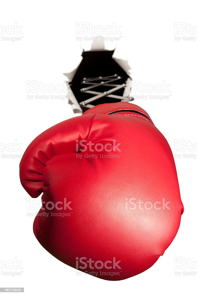 Red boxing glove bursts through white background royalty-free stock photo