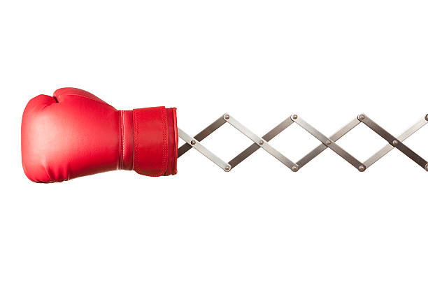 red boxing glove concertina on white background - sports glove stock photos and pictures