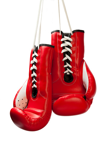 Red boxing gloves hung by their white laces