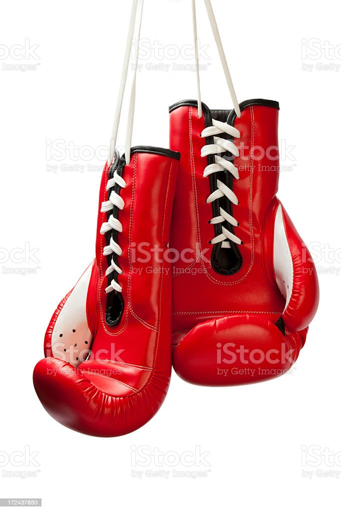 Red boxing gloves hung by their white laces stock photo