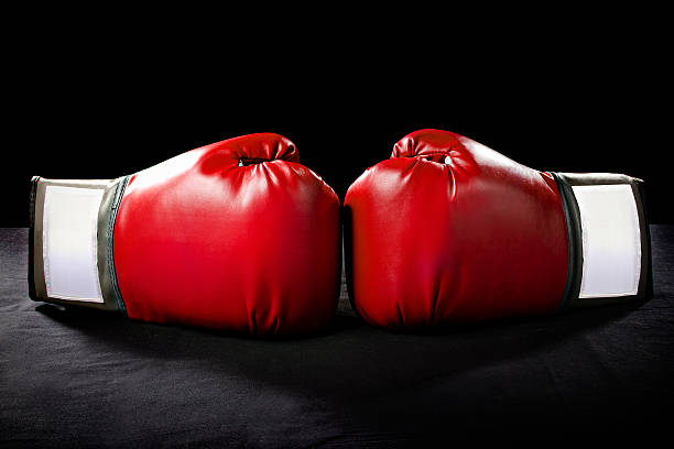 Red Boxing Gloves on a Black Background stock photo