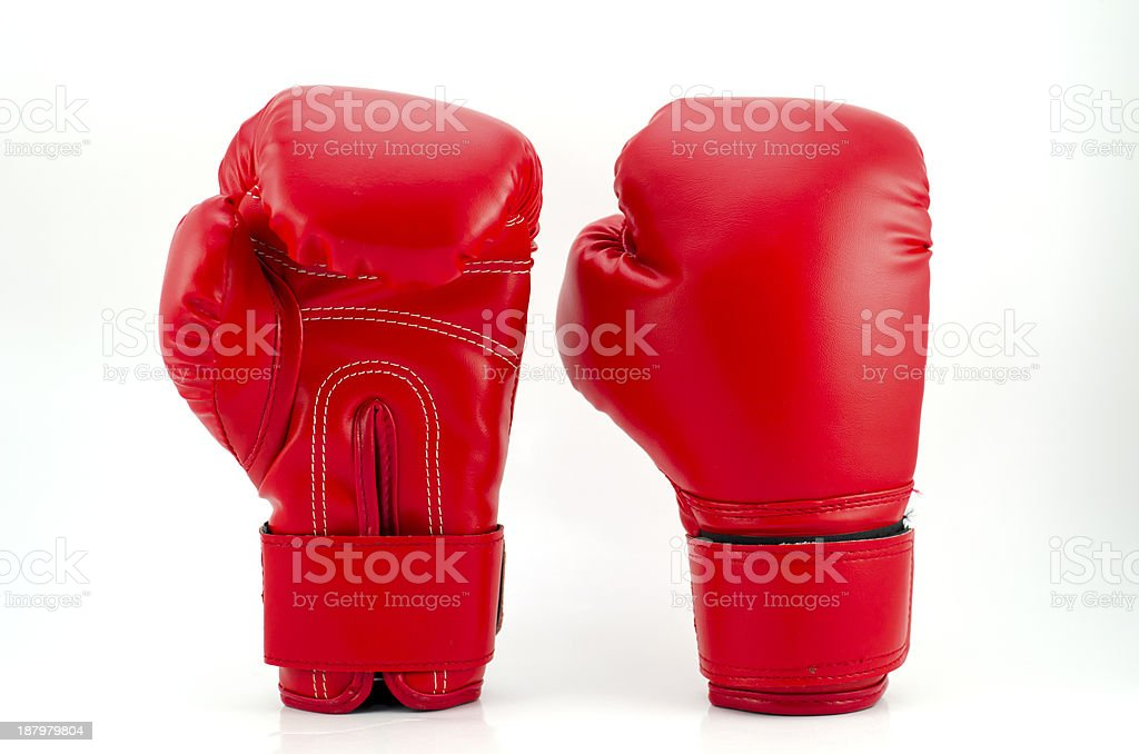 Red boxing gloves on grey background stock photo