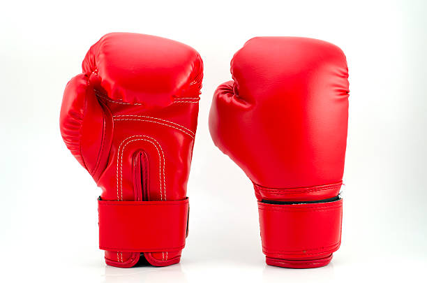 red boxing gloves on grey background - sports glove stock photos and pictures