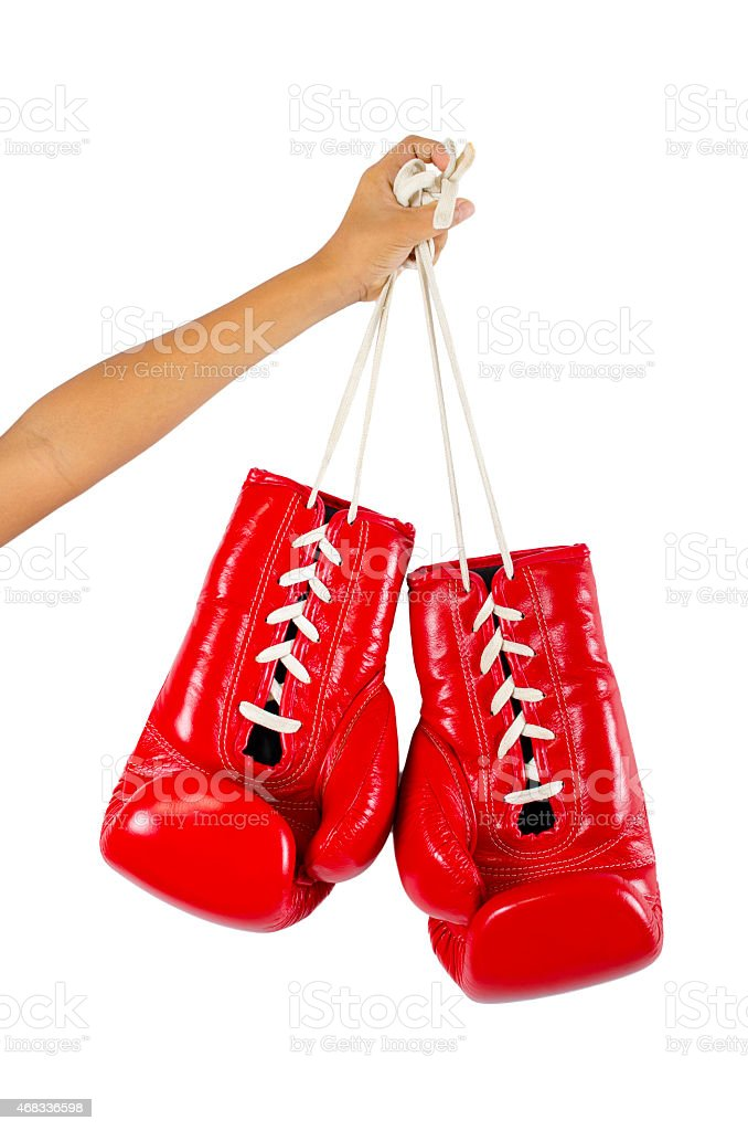 Red boxing gloves on hands isolated on white stock photo