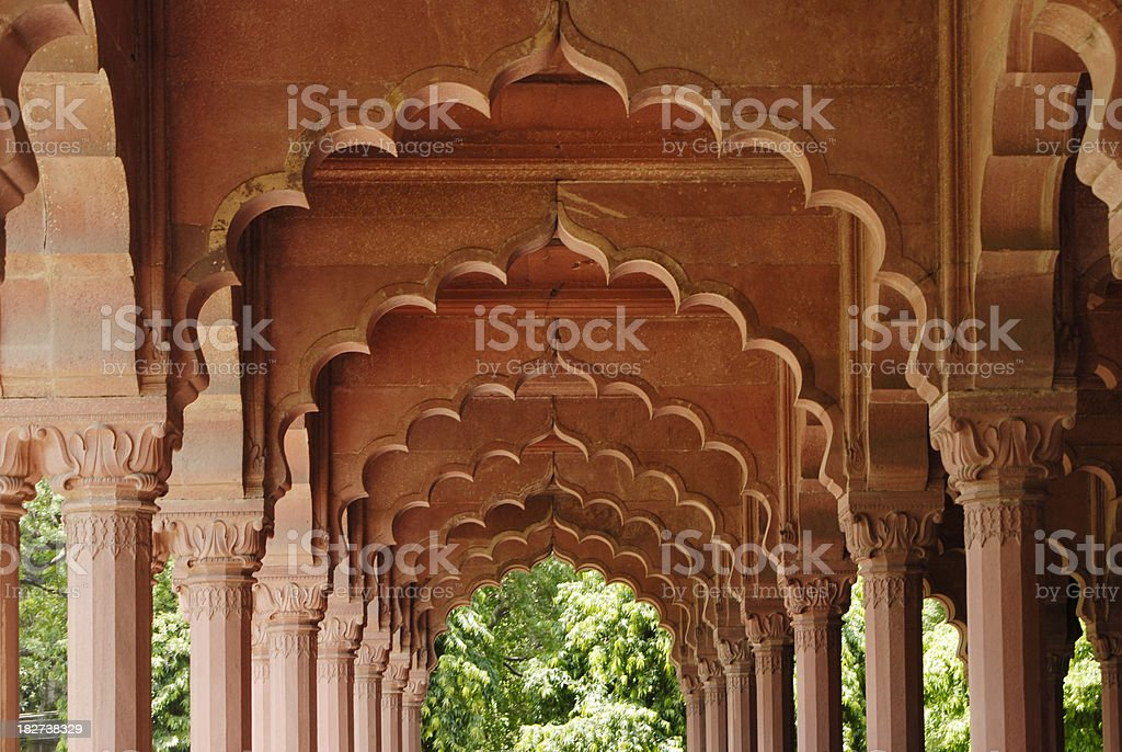 Red brick archways and colours at Indian temple royalty-free stock photo