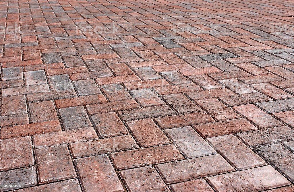 Red brick block paving on modern driveway / drive, herringbone pattern stock photo