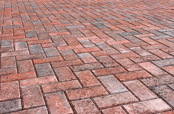 Red brick block paving on modern driveway / drive, herringbone pattern stock photo