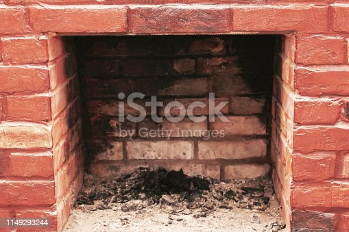 istock Red brick dirty fireplace with remains of ash after wooden firewood burnt in fireplace 1149293244
