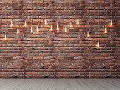 Red brick empty wall with light bulbs, background