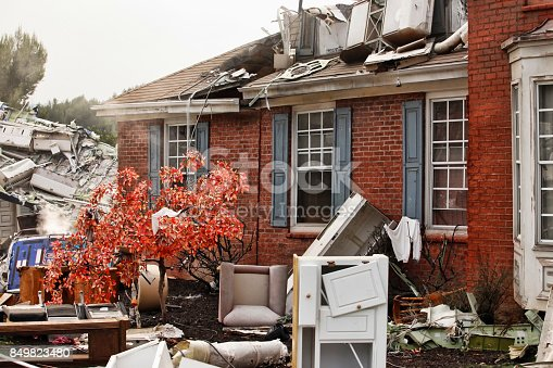 istock Red brick house, damaged by a natural disaster. 849823480