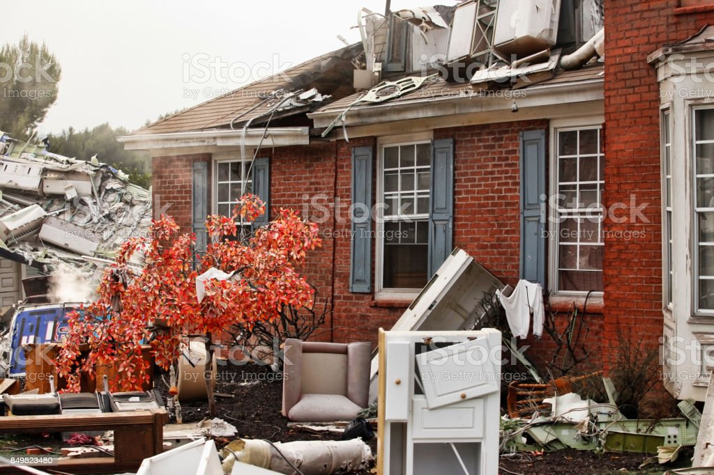 Red brick house, damaged by a natural disaster. stock photo