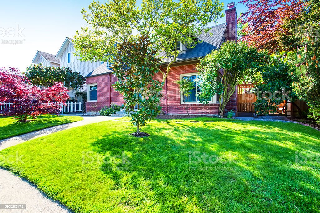 Red brick house exterior with well kept front garden royaltyfri bildbanksbilder