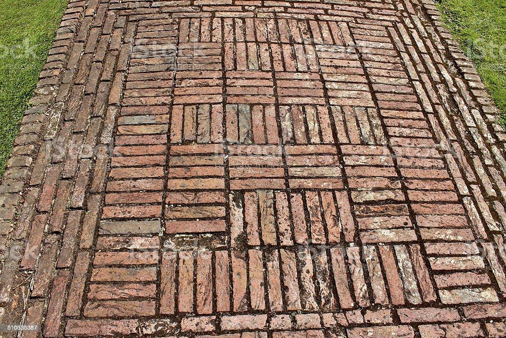 Red brick path, block paving image, paved pathway, basketweave pattern stock photo