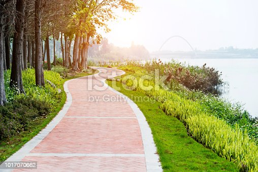 Red brick path by the lake.