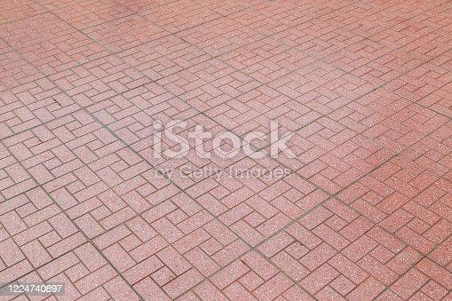 Red brick paving stones on a sidewalk background