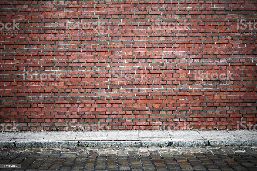Red Brick Wall and Cobblestones royalty-free stock photo