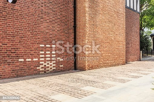 Red brick wall and empty floor sidewalk in the city streets