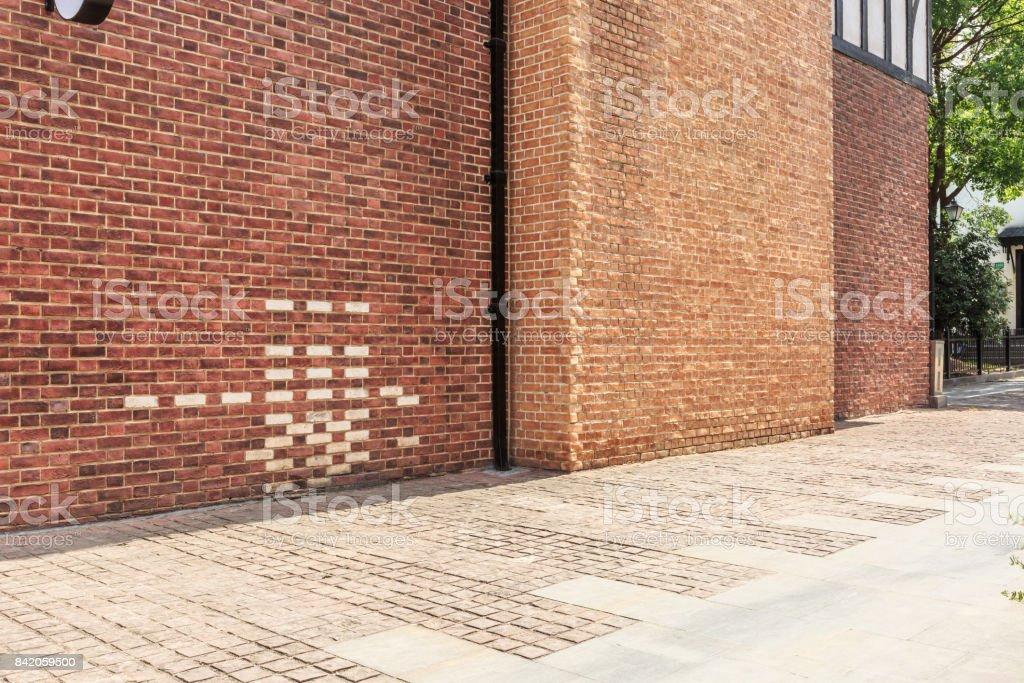 Red brick wall and empty floor sidewalk stock photo