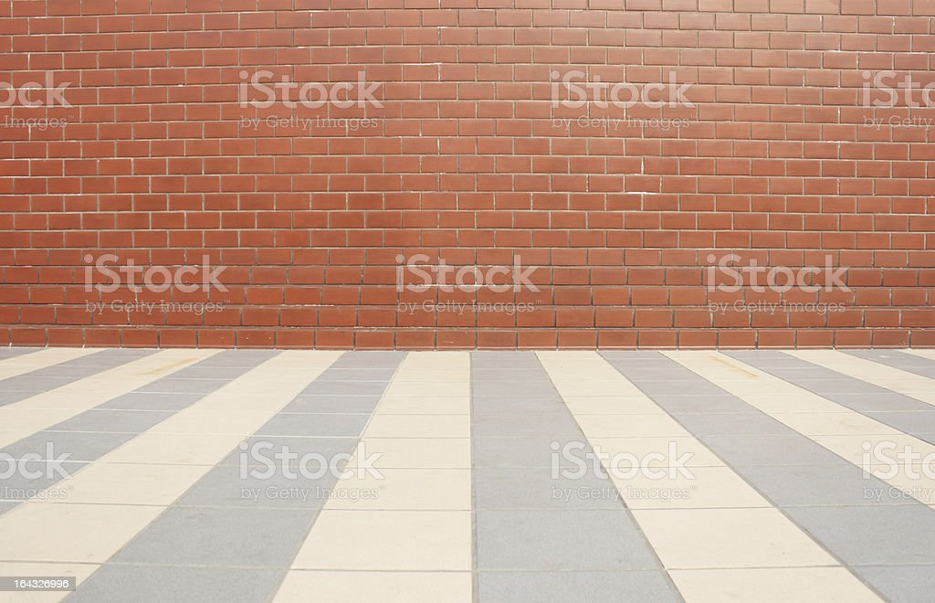 Red brick wall  and tiled floor royalty-free stock photo