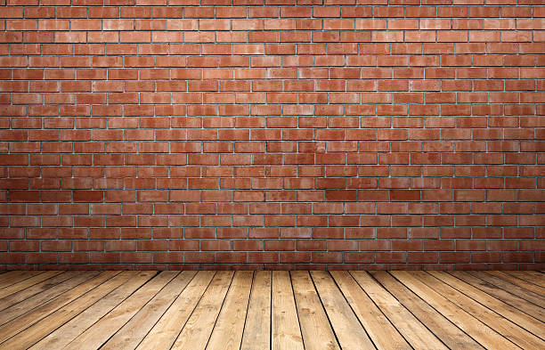 Red brick wall and wooden floor​​​ foto