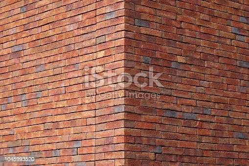 Red brick texture of the corner of the house. Red Brick wall for background or texture. Old red brick wall texture background