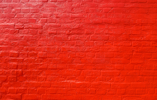 Bricks painted with a shiny red color.
