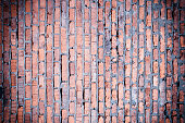 Red brick wall. Background with brickwork texture. Photo with vignette.