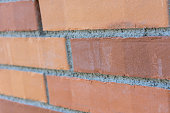 red brick wall close up modern new construction