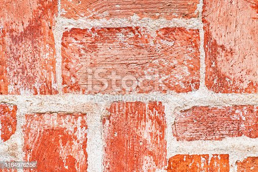 973649382istockphoto Red brick wall macro texture and background 1164976256