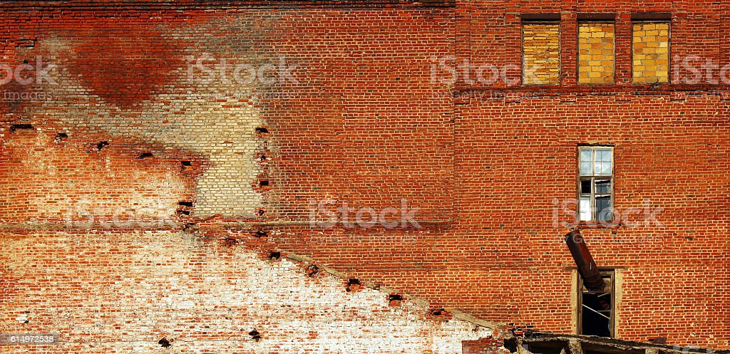 Red brick wall of old abandoned factory stock photo