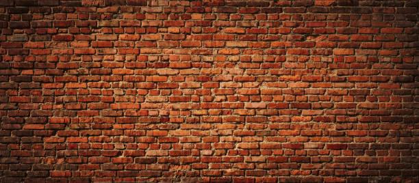 붉은 벽돌 벽 전경. - 벽돌 담 뉴스 사진 이미지