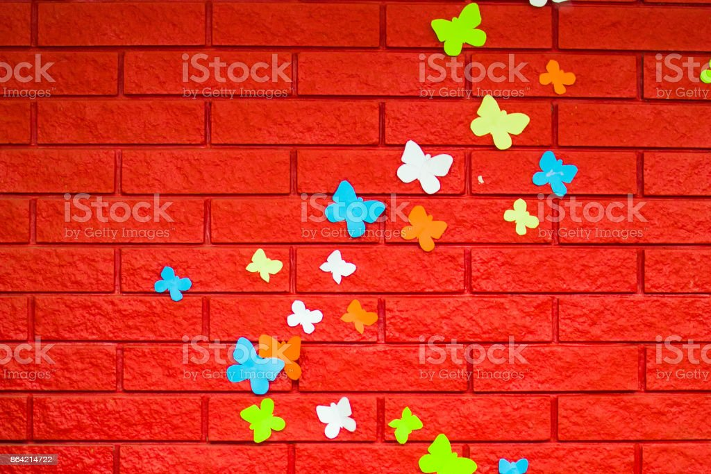 red brick wall with paper butterflies royalty-free stock photo