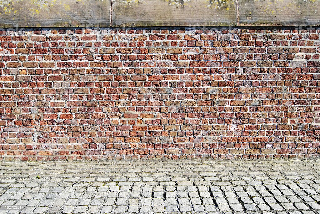 Red brick wall with sidewalk at the Albert Dock, Liverpool royalty-free stock photo