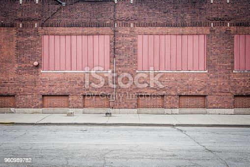 istock Red bricks framing red panels 960989782