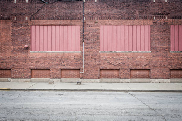 Red bricks framing red panels stock photo