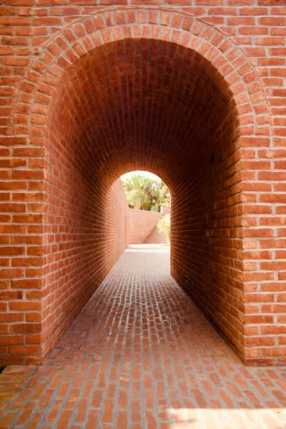 Red bricks made entrance gate unique photo stock photo