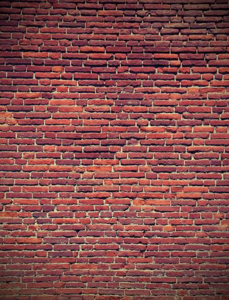 red bricks of an old wall with vintage effect stock photo