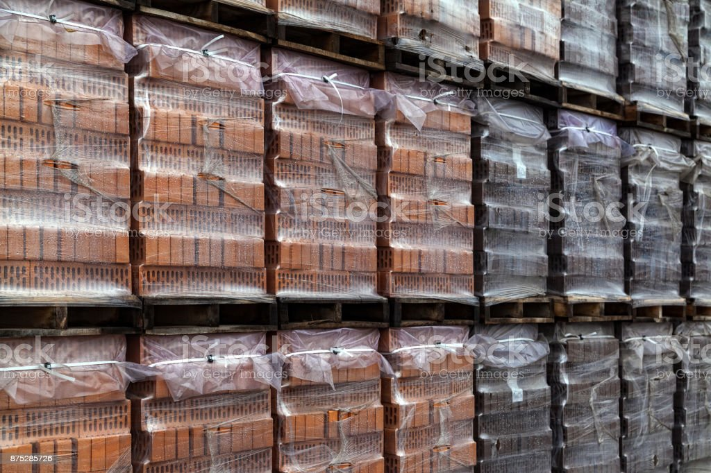 Red bricks stacked into cubes stock photo