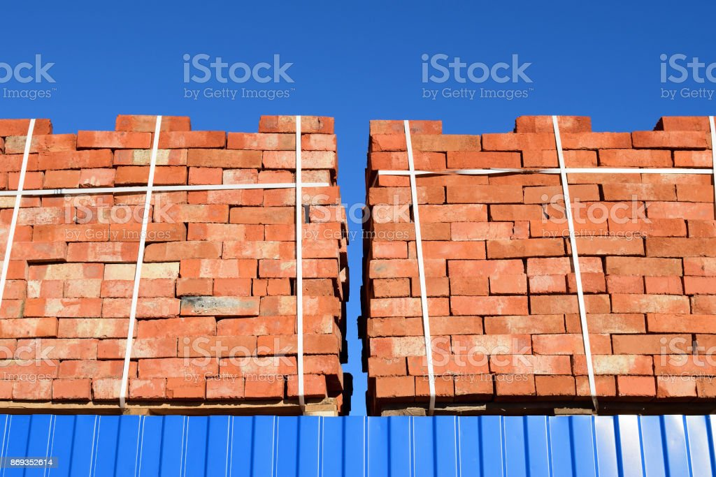 Red bricks stacked into cubes. Warehouse bricks. Storage brickwo stock photo