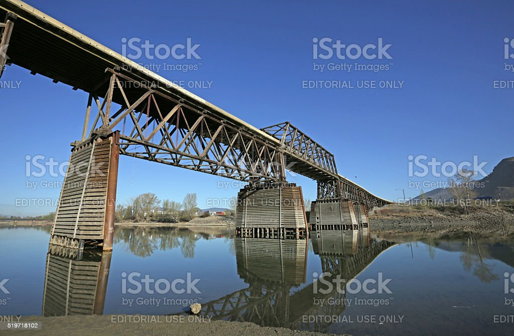 Red Bridge and Reflection in Thompson River, Kamloops, Canada stock photo
