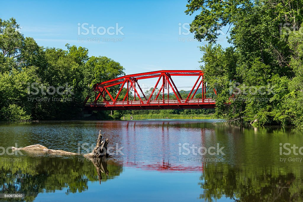 Red Bridge in bright daylight over the Wallkill River. stock photo