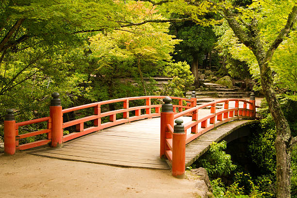 Red bridge in Japan Picture of a red bridge on the island of Miyajima. miyajima stock pictures, royalty-free photos & images