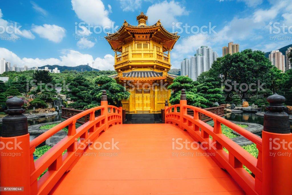 Red bridge in Nan Lian Garden, Diamond Hills, Hong Kong stock photo